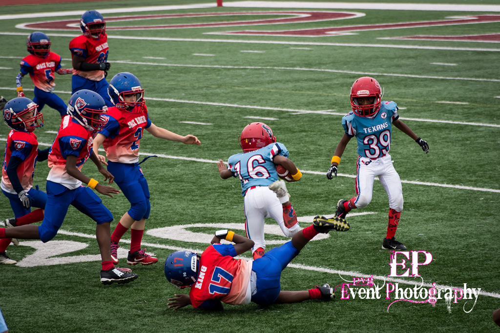 Clear Lake Space Raiders text book stiff arm and run over.