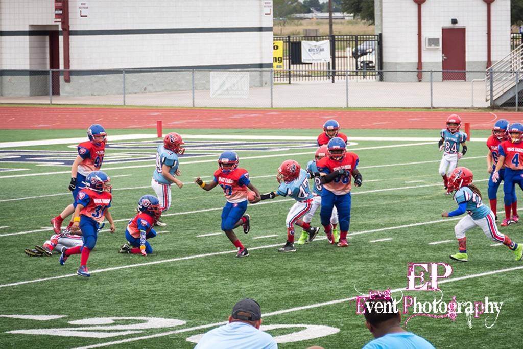 The running back cuts to the outside from the closest Clear Lake Space Raiders defensive team.