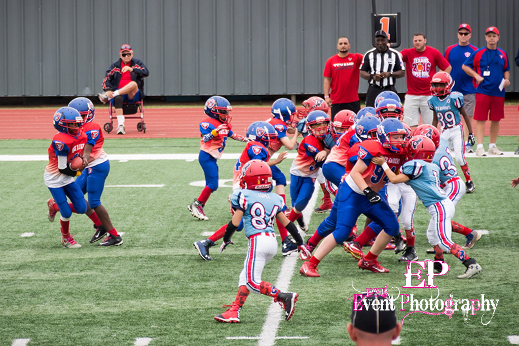 Hand-off in the background before the Clear Lake Space Raiders defense gets their hands on the running back.